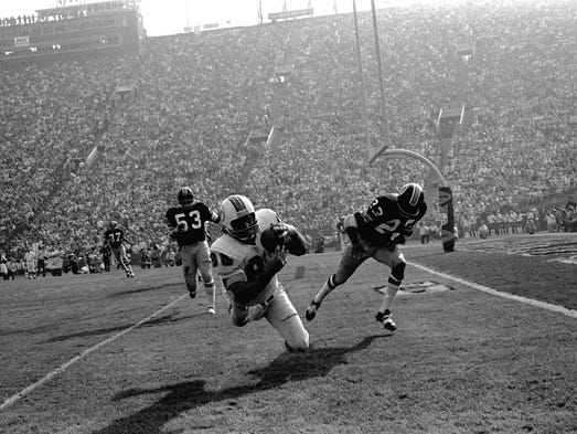 Super Bowl VII (Dolphins 14, Redskins 7): Miami Dolphins' Jim Mandich takes in a Bob Griese pass near the goal line during the second quarter. The 1972 Miami Dolphins remain the NFL's only team with a perfect record (17-0). The 1948 Cleveland Browns of the AAFC also posted a 14-0 record.
