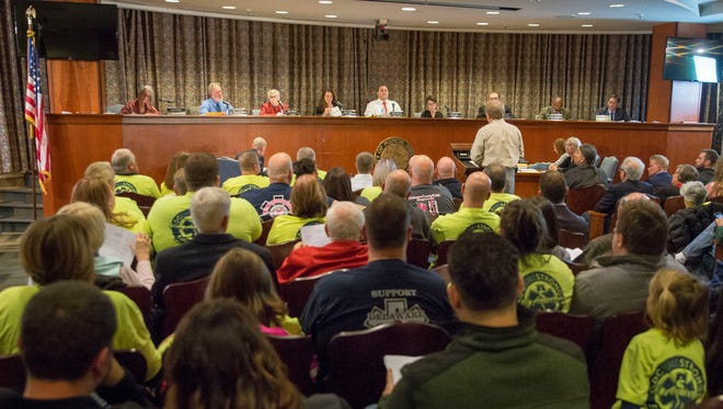 Members of the public pack into the Muncie City Council meeting on Dec. 4 at Muncie City Hall following a large debate around a city run EMS service. The council voted to send the proposal to committee for more information.