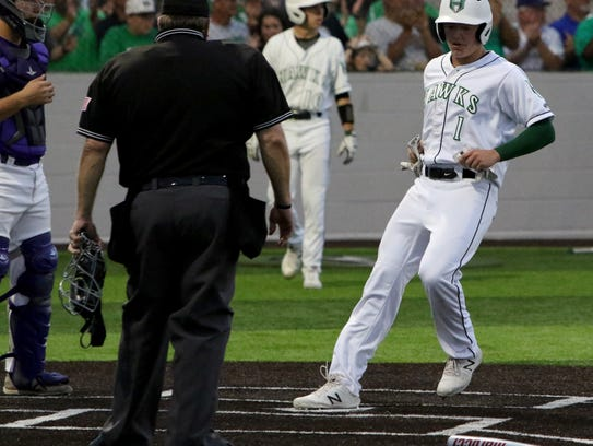 Iowa Park's Trent Green steps on home to score against