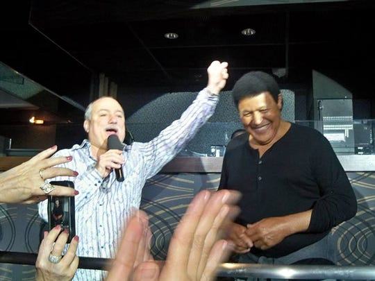 Bob Pantano shares memories with Twist king Chubby Checker at a past dance party.