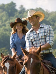"Britt Robertson and Scott Eastwood appear in a scene from ""The Longest Ride."""