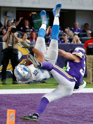 Lions wide receiver Golden Tate flips into the end zone in front of Vikings strong safety Andrew Sendejo after catching a 28-yard touchdown pass in overtime in Detroit's 22-16 victory over Minnesota last Sunday.