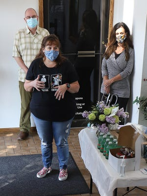 Founder and clinician Melanie Taylor, LPC-S, front, talks about the mission of the Healing Tree Women's Counseling Center, 5004 S U St., Suite 203, during the ribbon cutting for the Greater Fort Smith Chamber of Commerce, Tuesday, Oct. 6.