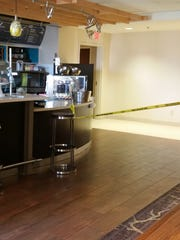 Sarah McKinney was shot four times in the kitchen area behind this bar at the Courtyard Marriott in the 4600 block of Southport Crossing Drive.