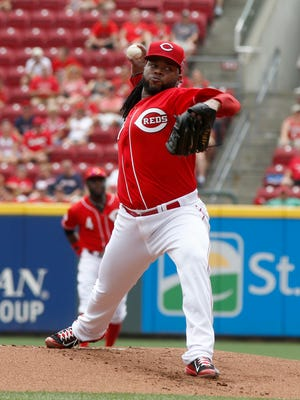 Cincinnati Reds starting pitcher Johnny Cueto throws against the Cleveland Indians in the first inning at Great American Ball Park.