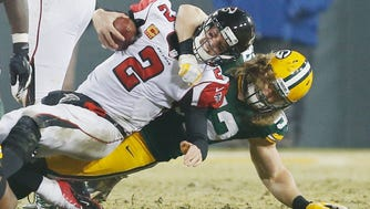 Green Bay's Clay Matthews, right, sacking  Atlanta QB Matt Ryan during a 2014 game,  The defenses will surely be tested when the Packers meet the Falcons in the NFC Championship.