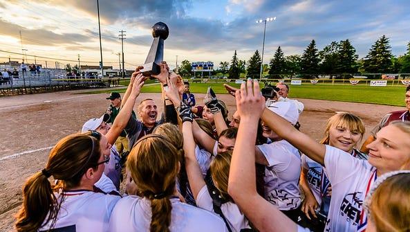 The Eaton Rapids softball team lifts the Softball Classic