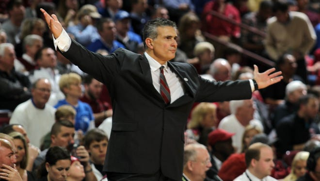 South Carolina coach Frank Martin shows his displeasure with a referee's call against Kentucky in the first half of an NCAA college basketball game, Saturday, Jan. 24, 2015, at the Colonial Life Arena in Columbia, S.C. (AP Photo/Willis Glassgow)