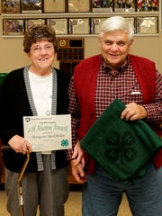 Margaret and Melvin Burkholder, Chambersburg, receiving 4-H Alumni Award