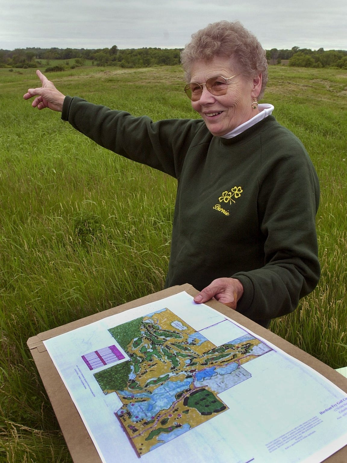 Bernice Millikin points to an area of her land that would one day become Erin Hills.