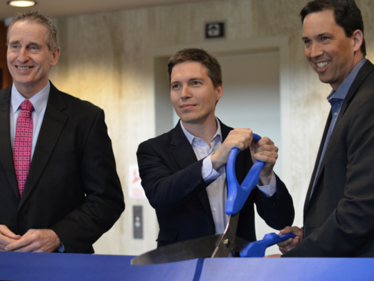 CoverWallet held a ribbon cutting to celebrate the opening of their Brighton location in April. (Bob Duffy, left, president of Greater Rochester Chamber of Commerce; Inaki Berenguer, center, co-founder and CEO of CoverWallet; Paul Rosen, COO of CoverWallet)