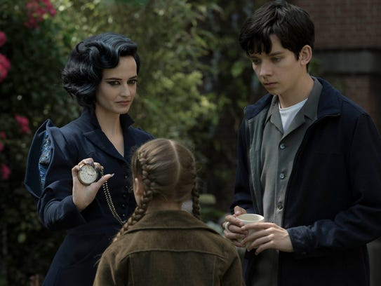 Miss Peregrine (left, Eva Green) demonstrates one of
