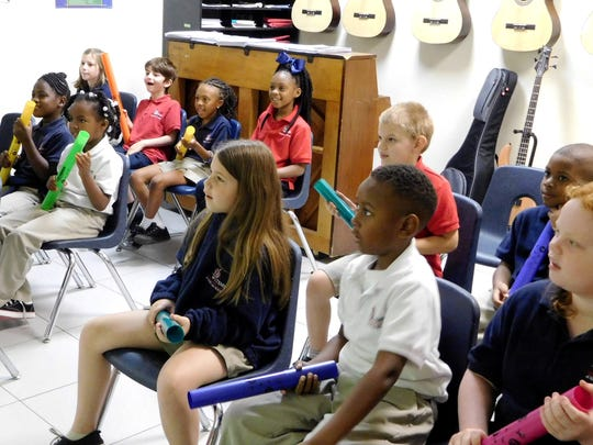 Music students use boomwhackers purchased with a COCA Arts in Education grant.