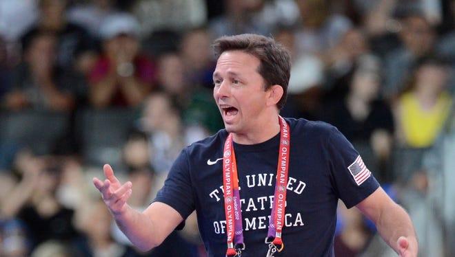 Zeke Jones, shown coaching at 2012 Olympics, is making a big splash in recruiting as Arizona State's new wrestling coach.