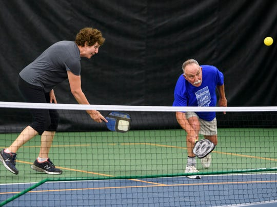 Emma Jean Couture (left) and Larry Congleton (right) rally with their competitors, Barbara Boone and Dick Vanzant (not pictured), during the Mixed Doubles 70-74 finals at the Indiana State Games Pickleball tournament inside the Evansville Tennis Center off of Lynch Road, Wednesday afternoon, May 23, 2018. All of them qualified to compete in the National Senior Games competition which will be held in Albuquerque, New Mexico, in June 2019.