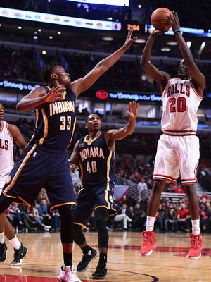 Chicago Bulls forward Tony Snell (20) shoots the ball against Indiana Pacers forward Myles Turner (33) during the second quarter at the United Center.