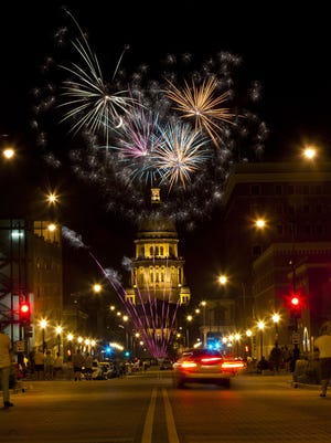 Fireworks explode over the Illinois State  Capitol building during the Capital City Celebration in downtown Springfield, Ill., Monday, July 4, 2011. Justin L. Fowler/The State Journal-Register