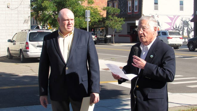 With Bridge Street as a backdrop, Corning Mayor Rich Negri, right, and City Manager Mark Ryckman extol the revitalization that has taken place on the city's  Northside in recent years.