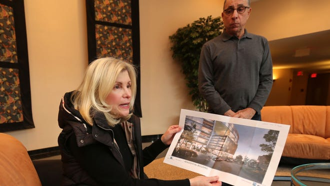 Residents Ilene Stockel and Ron Talarico talk the proposed complex to be built at the former Good Counsel property.