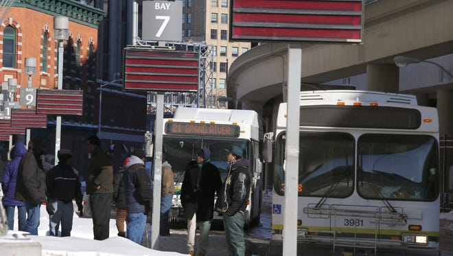 People wait for busses at the Rosa Parks Transit Center in downtown Detroit on Thursday, Feb. 5,  2015.