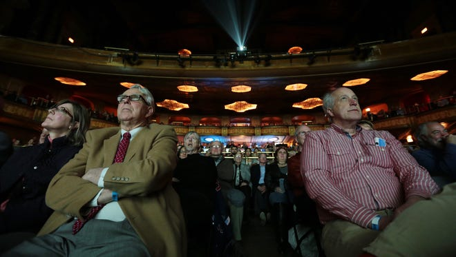 (Left to right front row) Mary Martin of Grosse Pointe, Gary Spicer of Grosse Pointe and Richard Evans of Ann Arbor watch Detroit Free Press photographer Eric Seals' film 'Graveyard of the Great Lakes: A Shipwreck Hunter's Quest to Discover the Past.'