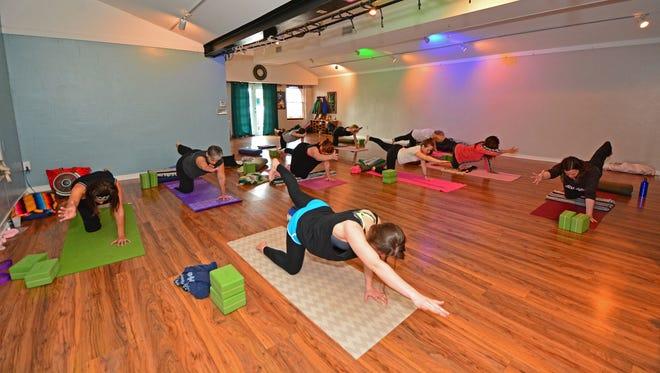 Christa Parent leads a gentle yoga class at Breathe Yoga Studio.