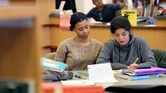 Briana Harrison,19 of Romulus studies Algebra with Dalia Alshemairy,24, of Westland at Bradner Library on campus at Schoolcraft College in Livonia, Tuesday, March 24, 2015.