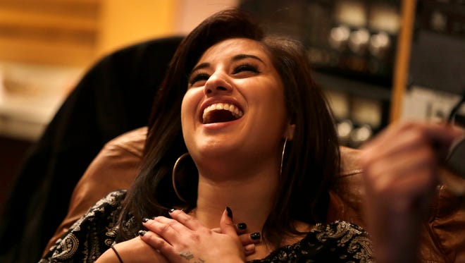 Artist Jena Irene reacts after hearing some good news during a recording session at Studio A in Dearborn Heights on Wednesday, April 15, 2015.