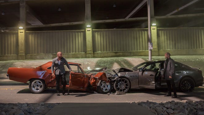 "Dom Toretto (Vin Diesel) faces off against Deckard Shaw (Jason Statham) in ""Furious 7."""