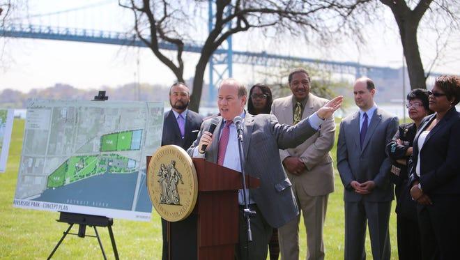 Mayor Mike Duggan announces a major agreement for expansion of Detroit's Riverside Park.