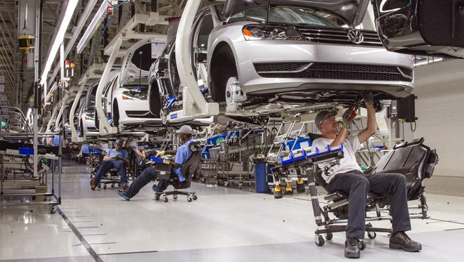 Employees at the Volkswagen plant in Chattanooga work on the assembly of a Passat sedan.
