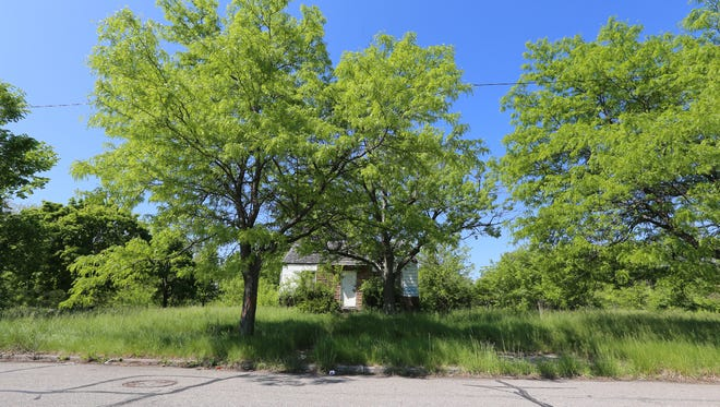 French Road has mostly vacant land with an abandoned house  Coleman A. Young International Airport, also known as Detroit City Airport, in the city's east side on Thursday, May 29, 2014.