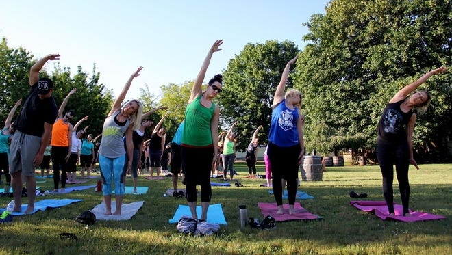 About 100 people participate in Hopyard Yoga at Rogue Farms.