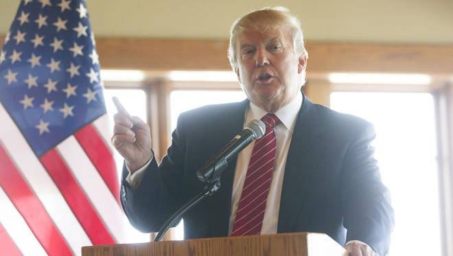 Donald Trump speaks to guests at Brown Deer Golf Course in Coralville on Thursday. Trump was the keynote speaker at the luncheon, which benefited the proposed Coralville Veterans Memorial.