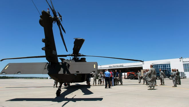 Iowa Gov. Terry Branstad and Lt. Gov. Kim Reynolds are taken to see a UH-60M Black Hawk helicopter during their tour of the 132nd Wing at the Iowa Air National Guard on Tuesday, June 9, 2015.