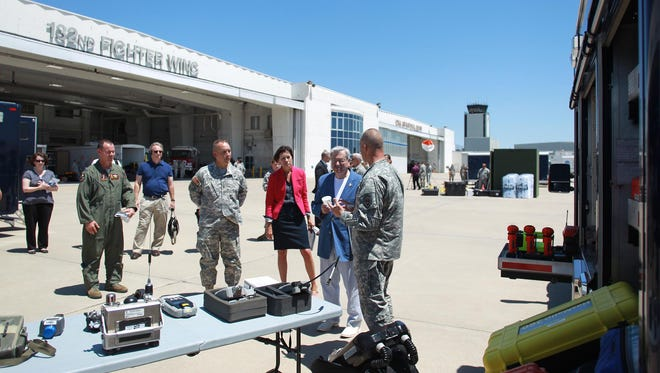Gov. Terry Branstad and Lt. Gov. Kim Reynolds take a tour of the 132nd Wing of the Iowa Air National Guard at the Des Moines airport on June 9. The airport and the Guard unit have been involved in a yearlong dispute over the unit's lease.