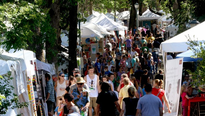 Crowds visit the Salem Art Fair at Bush's Pasture Park on Sunday, July 19, 2015. Applications for artists, performers and organizations who wish to participate in the 2016 fair are now open.
