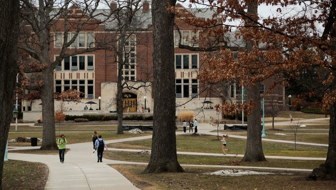 Students walk through the Michigan State University campus in East Lansing on Monday, March 16, 2015.