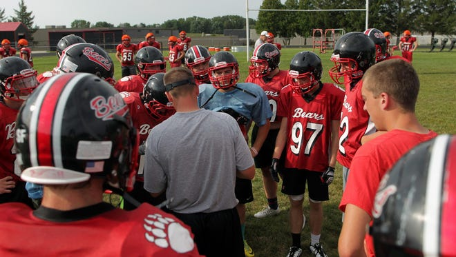 West Branch players wait for a play during practice on Thursday, Aug. 13, 2015.