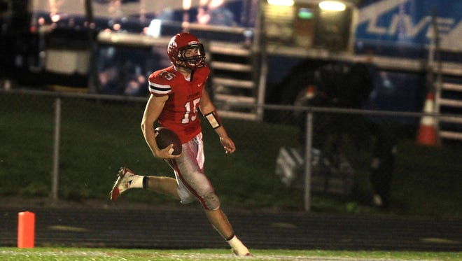 City High quarterback Nate Wieland runs in for a 57-yard touchdown during the Little Hawks' game against Cedar Rapids Prairie at City High on Thursday, Oct. 2, 2014.   David Scrivner / Iowa City Press-Citizen