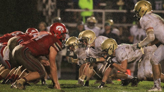 Little Hawks and Trojans line up for a play during their game at City High on Friday, Sept. 18, 2015.