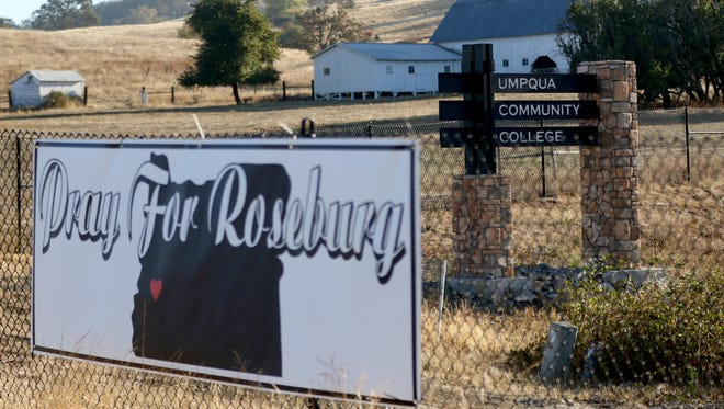Signs near the Umpqua Community College campus in Roseburg, Ore., on Friday, Oct. 2, 2015. Ten people were killed and seven others injured in a shooting at Umpqua Community College on Thursday.