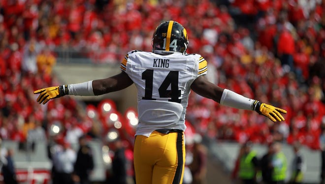 Iowa's Desmond King celebrates after forcing a fourth down during the Hawkeyes' 10-6 win at Wisconsin on Saturday.