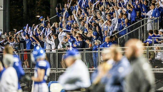Novi Detroit Catholic Central fans go wild Oct. 9, 2015.