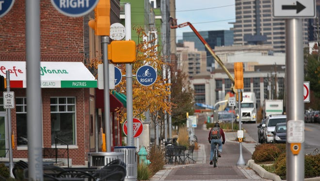 The development along Virginia Avenue in the city's Fletcher Place and Holy Rosary neighborhoods, as seen here on Nov. 6, 2015, has turned the Southeastside area into one of the city's hotspots with an ecletic mix of retailers and apartment buildings.