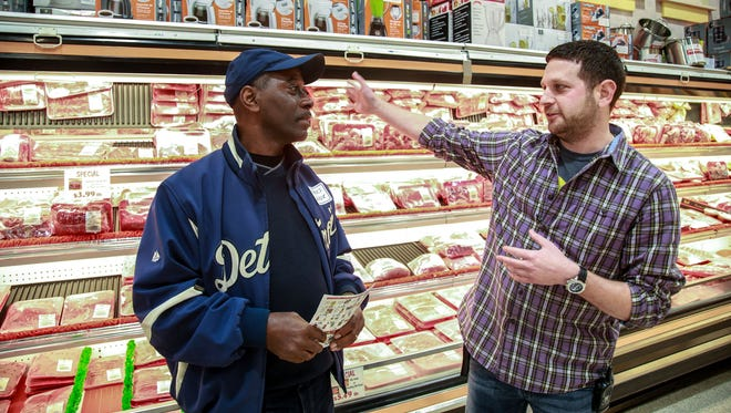 Charles Walker, 57, of Detroit, left, talks with E&L Supermercado co-owner Mke Fienman during the Green Grocer Project grocery store crawl at E&L Supermercado in southwest Detroit on Saturday, Nov. 14, 2015. Walker said he owned a Save-A-Lot for six years before it closed in 2010 and now works for the nonprofit Fair Food Network.