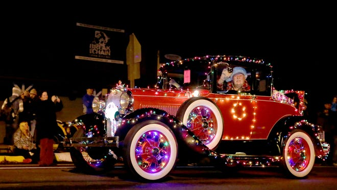 A decorated car drives in the fifth annual Sublimity Light Parade in Sublimity, Ore., on Saturday, Dec. 5, 2015.