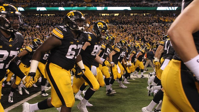 Iowa takes the field for the Big Ten Championship game against Michigan State at Lucas Oil Stadium in Indianapolis, Ind. on Saturday, Dec. 5, 2015.