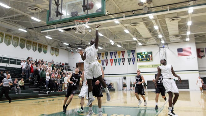 West High's Devontae Lane goes up for a shot during the Trojans' game against Mount Vernon on Thursday, Dec. 3, 2015.