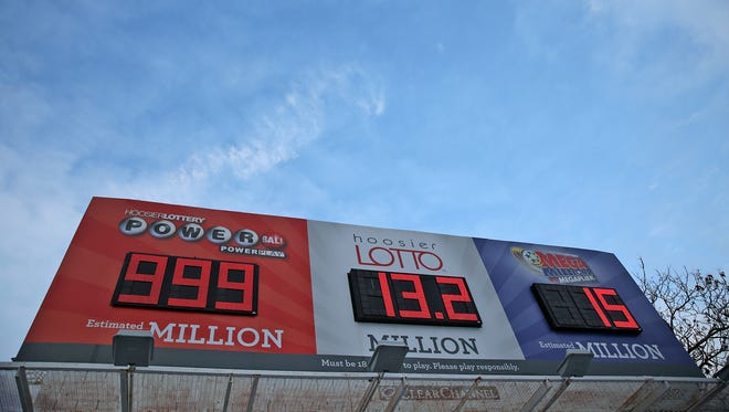 Bigger-than-life lottery jackpots are posted above the intersection of 16th and Illinois streets in Indianapolis on Monday, Jan. 11, 2016. The Powerball prize, estimated to be $1.4 billion by Wednesday's drawing, is bigger than the board can handle.